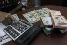 Photo of Tras permitir dolarización de facto, régimen venezolano anunció nuevo  impuesto a las transacciones en divisas